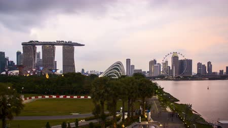 Time lapse of dusk day to night sunset at Marina Bay Singapore. Tilt down