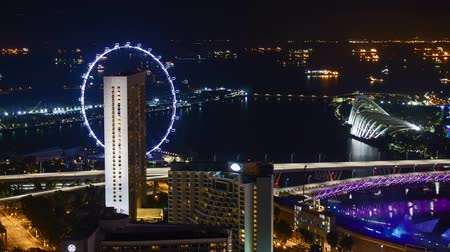 Time lapse of night scene at Marina Bay Singapore. Pan right