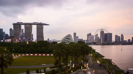central business district : Time lapse of dusk day to night sunset at Marina Bay Singapore.