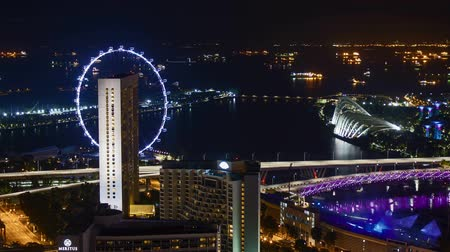 Time lapse of night scene at Marina Bay Singapore. Zoom in