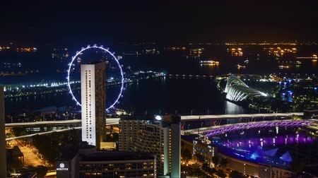 Time lapse of night scene at Marina Bay Singapore. Tilt down