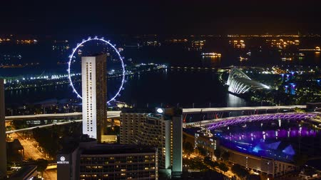 tilt : Time lapse of night scene at Marina Bay Singapore. Tilt up