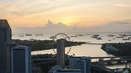 Time lapse of sunrise at Marina Bay Singapore. Pan left