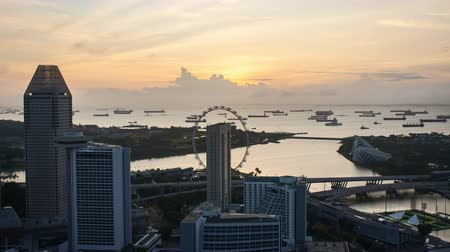 Time lapse of sunrise at Marina Bay Singapore. Tilt down