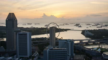 Time lapse of sunrise at Marina Bay Singapore. Tilt up