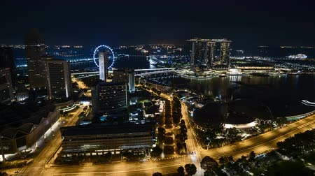 Time lapse of night scene at Singapore city. Pan right Vídeos