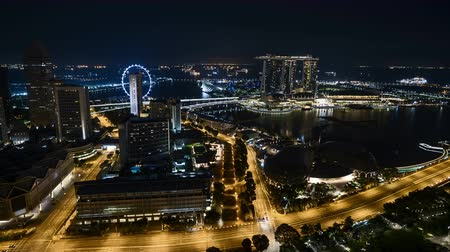 Time lapse of night scene at Singapore city. Pan left Vídeos