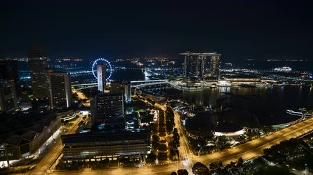 Time lapse of night scene at Singapore city. Zoom in