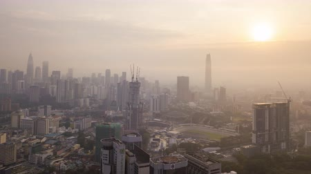 4k establishing b-roll cinematic shot of hyperlapse drone view of sunrise at Kuala Lumpur city skyline. Vídeos