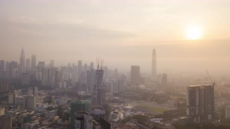 4k establishing b-roll cinematic shot of hyperlapse drone view of sunrise at Kuala Lumpur city skyline. Tilt up