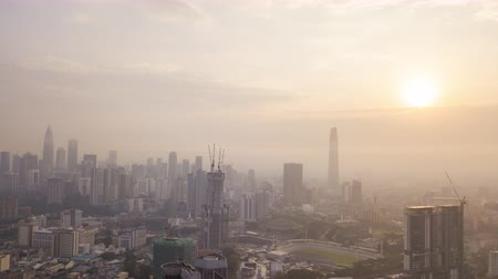 4k establishing b-roll cinematic shot of hyperlapse drone view of sunrise at Kuala Lumpur city skyline. Tilt down