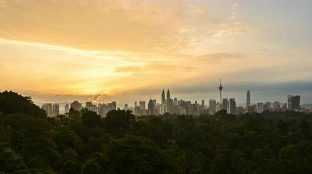 4k time lapse of clear sunrise from Kuala Lumpur city skyline. Zoom out