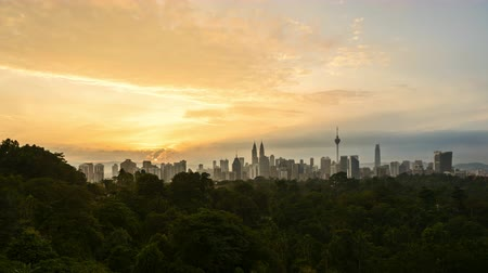 4k time lapse of clear sunrise from Kuala Lumpur city skyline. Zoom in