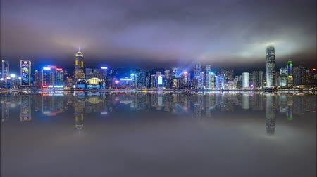 4k time lapse of night scene at Hong Kong city skyline during daily light show, with reflection effect.