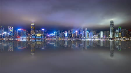 4k time lapse of night scene at Hong Kong city skyline during daily light show, with reflection effect. Tilt down