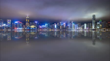 4k time lapse of night scene at Hong Kong city skyline during daily light show, with reflection effect. Tilt up