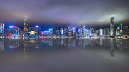 4k time lapse of night scene at Hong Kong city skyline during daily light show, with reflection effect. Zoom in