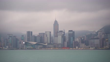 icc : Establishing cinematic b-roll shot of cloudy and misty Hong Kong city skyline. Stock Footage