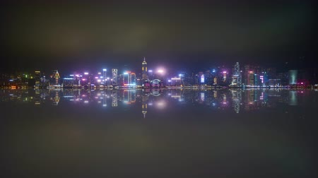 water show : 4k time lapse of night scene at Hong Kong city skyline during daily light show, with reflection effect.