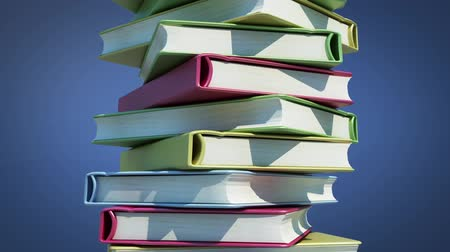 livros : Pile of rotating books on blue background with alpha included - endless loop