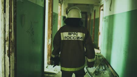 destroyed building : Russian fireman exploring buildin after fire