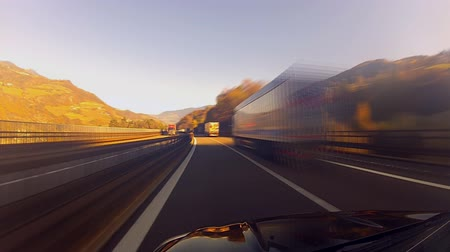 droga : Driving on highway in Alps, trucks passing, time-lapse