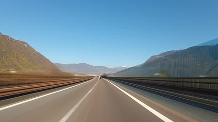 hasznosság : Driving on highway in Alps, time-lapse Stock mozgókép