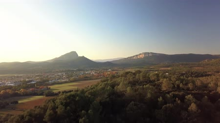 Autumnal aerial view of Saint Loup Peak at sunset, Occitanie, France