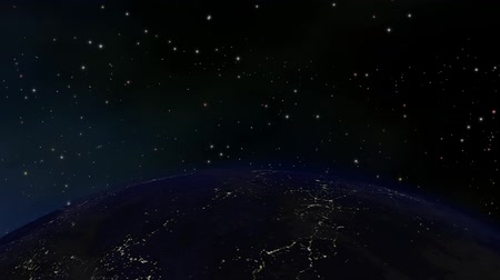 Earth at night, orbiting through space