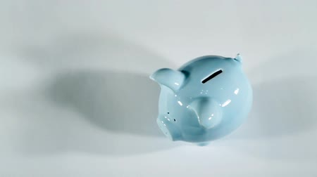 piggy bank : Putting coins in piggy bank