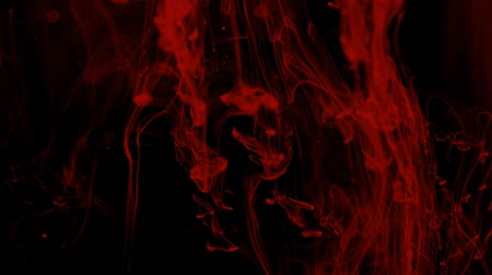 whirling : Red liquid swirls over black