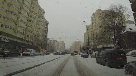 traffic bucharest : BUCHAREST, ROMANIA - JANUARY 26, 2014: Heavy snowfall in Bucharest. Romania declared Code Red over hazardous weather. Three motorways in the country were closed for traffic. Stock Footage