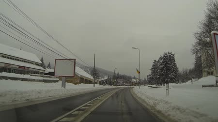 viagem por estrada : NATIONAL ROAD NO.1, ROMANIA - JANUARY 26, 2014: Heavy snowfall. Romania declared Code Red over hazardous weather. Three motorways in the country were closed for traffic.