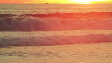 Ocean waves during golden sunset