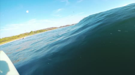 POV of the surfer riding the small wave