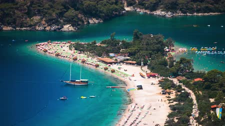 Sunny day timelapse (vertical panorama) of the beach of Oludeniz and Blue Lagoon, Fethiye, Turkey