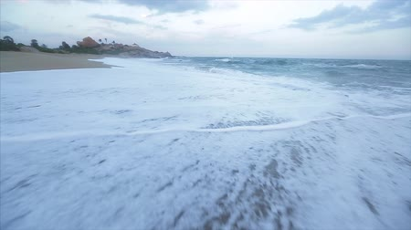 Sea wave comes on the sandy beach. Hand held camera Wideo