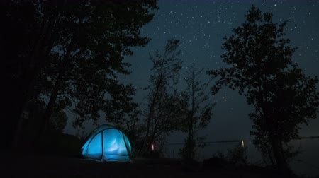 Starry sky timelapse with illuminated tent