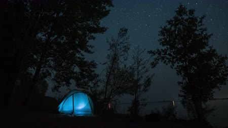 Starry sky time lapse with illuminated tent Wideo