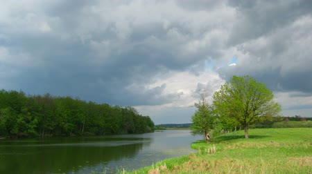 napfény : timelapse with storm clouds moving over lake Stock mozgókép