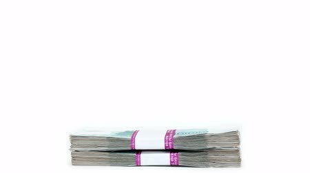 rakás : money concept - stack of banknotes packages increases and decreases Stock mozgókép