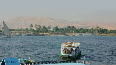 aswan : boats on Nile River in Luxor, Egypt - timelapse
