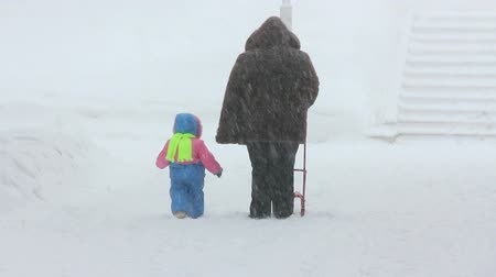 nadváha : mother and child walking at winter