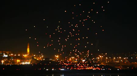 festivais : many Japanese Lantern flies over city at night - timelapse
