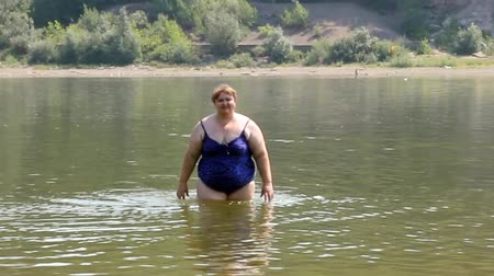 пухлый : woman with overweight bath in river