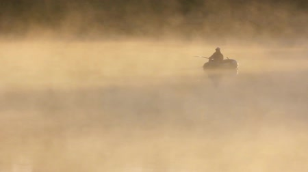 fishermen : morning fishing on river in fog