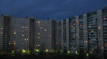 blocks of flats : Day replaces night on background of house and sky, time lapse Stock Footage