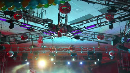 boate : lighting equipment  at concert - colored spotlights on ceiling