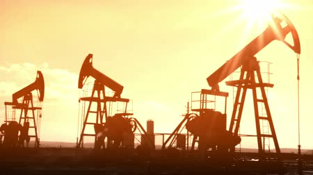 gas : working oil pumps silhouette - old movie styled Stock Footage