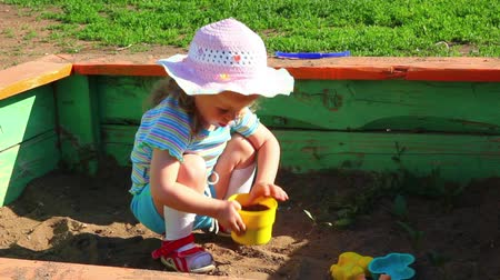 brown : little girl playing in sandbox Stock Footage